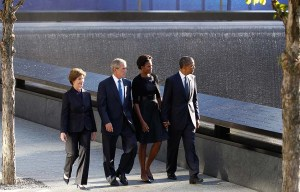 U.S. President Barack Obama, first lady Michelle Obama, former U.S. President George W. Bush and former first lady Laura Bush walk beside the WTC Memorial during the 10th anniversary of the 9/11 attacks on the World Trade Center