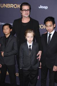 Brad-Pitt-Maddox-Pax-Shiloh-Jolie-Pitt-Unbroken-Movie-Premiere-Suit-Los-Angeles